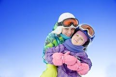Happy family at the ski resort Stock Photos