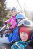 Happy family ski team fun on beautiful mountain. Ski, snow, sun and winter fun Royalty Free Stock Photo