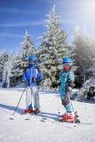 Happy family ski team fun on beautiful mountain. Ski, snow, sun and winter fun Royalty Free Stock Image
