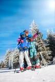 Happy family ski team fun on beautiful mountain. Ski, snow, sun and winter fun Royalty Free Stock Photography