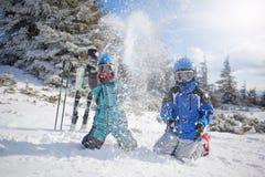 Happy family ski team fun on beautiful mountain. Ski, snow, sun and winter fun Royalty Free Stock Photos