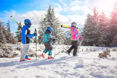 Happy family ski team fun on beautiful mountain royalty free stock photos