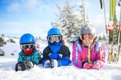 Happy family ski team fun on beautiful mountain. Ski, snow, sun and winter fun Stock Photo