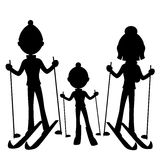 Happy family skiing. Royalty Free Stock Images