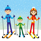 Happy family skiing. Stock Photo