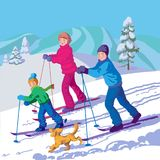 Happy family is skiing in the winter day. Father, mother and son are skiing in the mountains Royalty Free Stock Images