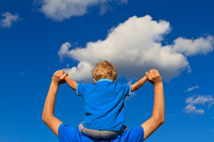 Happy family on sky. Happy family of father and baby with the sky on the background Stock Photography