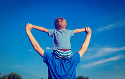 Happy family on sky. Happy family with the sky on background Stock Photography