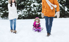Happy family with sled walking in winter forest Stock Photography