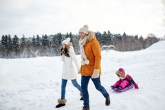 Happy family with sled walking in winter outdoors Stock Photography