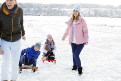 Happy family with sledge outdoors. On winter day stock photography