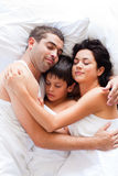 Happy family sleeping together Stock Photo