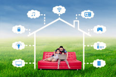 Happy family with smart house technology system Stock Photos