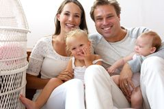 Happy family smiling with baby Stock Photo