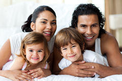 Happy family smiling at the camera Royalty Free Stock Photography