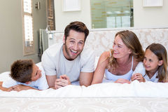 Happy family smiling at camera Stock Image