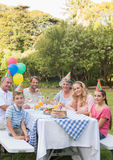 Happy family smiling at camera at birthday party Royalty Free Stock Images