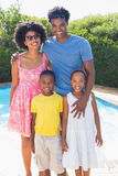 Happy family smiling at camera Royalty Free Stock Photos
