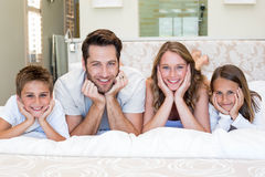 Happy family smiling at camera Stock Images