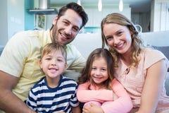 Happy family smiling at camera Stock Image