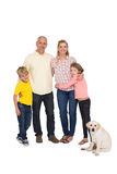 Happy family smiling at camera with pet dog Stock Images