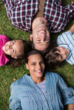 Happy family smiling at camera Royalty Free Stock Photo
