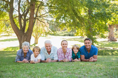 Happy family smiling at the camera Royalty Free Stock Images