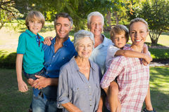 Happy family smiling at the camera Stock Images