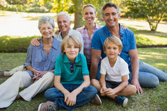 Happy family smiling at the camera Stock Image