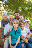 Happy family smiling at the camera. On a sunny day stock photography