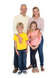 Happy family smiling at camera Royalty Free Stock Photography