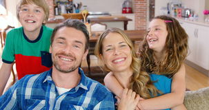 Happy family smiling on couch