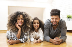 Happy family smiling and enjoying together Stock Photography