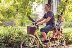 Happy family. Father and son riding bike in the park. Family spo Royalty Free Stock Image