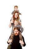 Happy family smiling and forming a tower. stock image