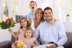 Happy family smiling at home Stock Photography