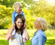 Happy family with smiling mother and grandmother. Portrait of a happy family with smiling mother and grandmother stock images