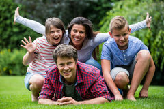 Happy family smiling in park Royalty Free Stock Photo