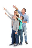 Happy family smiling and pointing at something Stock Image