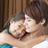 Happy family with smiling, positive, lovely daughter and mother. Happy family with smiling, positive daughter hugging her mother stock photos