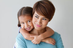 Happy family with smiling, positive lovely daughter and mother Stock Photos