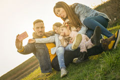 Happy family in the park. stock photography