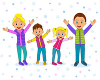 Happy family smiling with their hands up in winter Royalty Free Stock Images