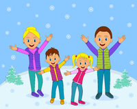 Happy family smiling with their hands up in winter Royalty Free Stock Image