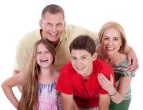 Happy family smiling towards the camera royalty free stock image