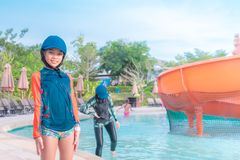Family is smiling in water park aqua amusement park Thailand stock photography