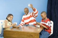 Happy family at snack time Stock Images