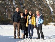 Happy family in snow Stock Image