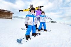 Happy family snowboarder snowboarding winter stock photos