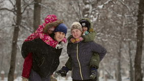 Happy family during a snowfall stock footage